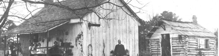 Fr.-Judge-standing-in-doorway-of-sacristy.-His-first-chapel-3-700x180